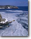 Stock photo. Caption: Gold Rock Point   and Lake Superior Split Rock Lighthouse   State Park, Minnesota -- united states america midwest midwestern upper north woods parks snow snowy cliffs headlands great lakes shoreline winter lakeshore frozen freezing parks frigid ice icey flow flowing landscape landscapes lakeshore lakeshores shoreline lighthouses