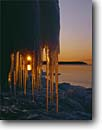 Stock photo. Caption: Sunset over Lake Superior Cascade River State Park Cook County Minnesota -- upper midwest united states america great lakes icicles sunburst frozen freezing parks icey cold artistic nature sunsets winter landscape landscapes rays light chilly pure shoreline shorelines region water