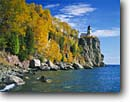 Stock photo. Caption: Split Rock Lighthouse   State Park Lake Superior North Shore, Minnesota -- light lights parks lighthouses station stations headland headlands great lakes fall autumn united states america color colors protection beacon beacons direction guidance landscape landscapes building buildings shoreline foliage shore strength sunny clear