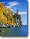Stock photo. Caption: Split Rock Lighthouse Lake Superior Split Rock Lighthouse State Park Minnesota -- light lights parks lighthouses station stations headland headlands great lakes fall autumn united states america color colors protection beacon beacons direction guidance colour colours building buildings landscape landscapes sunny blue sky skies clear