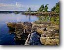 Stock photo. Caption: Anderson Bay Rainy Lake Voyageurs National Park Minnesota -- lakeshore lakeshores rocky shore shoreline bays lakes north america united states summer stone landscape landscapes great lakes region parks glassy remote isolated solitude midwest midwestern canoeing kayaking area areas sunny clear blue sky skies