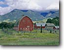 Stock photo. Caption: Working ranch Paradise Valley Park County Rocky Mountains,  Montana -- landscape landscapes scenic scenics scene barns building buildings pastoral rural agriculture mesas mountain rockies barn ranches summer ranchland mountain home homes houses family place isolated classic road roads summer ranching cloudy