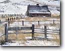Stock photo. Caption: Old barn   near Livingston Park County Montana -- united states america landscapes landscape scenic scenics barns americana winter snowy snow fences ranch ranches building buildings cattle desolate isolated tenacity surviving tenacious family working occupations wooden