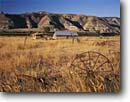 Stock photo. Caption: Rusted farm equipment at abandoned Kipp       Homestead  along the Missouri River Upper Missouri Breaks National Monument Montana -- americana nostalgic nostalgia united states america historic historical building buildings rural farm ranching ranch vintage travel homesteads rustic