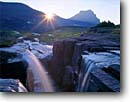 Stock photo. Caption: Reynolds Creek and Going-to-the-Sun  Mountain,  Logan Pass Glacier National Park Rocky Mountains, Montana -- falls waterfall waterfalls sunbeam sunbeams sunburst sunrise summer  parks rockies creeks alpine world heritage site sites water flowing freedom fresh clean clear divergence diverse converge convergence confluence time wisdom balance balanced landscapes