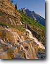 Stock photo. Caption: Falls on Haystack Creek and Mt. Cannan Glacier National Park Rocky Mountains,  Montana -- falls waterfall waterfalls summer parks northern rockies creeks alpine world heritage site sites cascade cascades water flowing fresh clean clear wild free ledge travel destination destinations vacation family landscape landscapes sunny steps