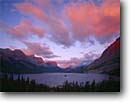 Stock photo. Caption: Sunrise, Wild Goose Island Saint Mary Lake  Glacier National Park Rocky Mountains, Montana -- united states america world heritage site sites clouds summer alpenglow mountains rockies peaks islands lakes mountain glacial carved valley valleys parks landscape landscapes tourist travel vacation destination destinations spectacular breathtaking drama
