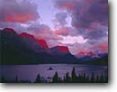 Stock photo. Caption: Sunrise clouds over Wild Goose Island Saint Mary Lake Glacier National Park Rocky Mountains,  Montana -- united states america world heritage site sites clouds summer alpenglow mountains rockies peaks islands lakes mountain glacial carved valley valleys parks landscape landscapes tourist travel vacation destination destinations spectacular breathtaking drama