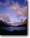 Stock photo. Caption: Sunrise clouds over Wild Goose Island Saint Mary Lake Glacier National Park Rocky Mountains,  Montana -- united states america world heritage site sites clouds summer alpenglow mountains rockies peaks islands lakes mountain glacial carved parks sunrise landscape landscapes tourist destination destinations spectacular breathtaking drama moon moons