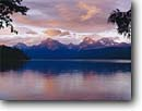 Stock photo. Caption: Lake McDonald   and the Lewis Range Glacier National Park Rocky Mountains, Montana -- landscape landscapes scenic scenics scene summer rockies mountain parks vistas vacation destination destinations water lakes landmarks landmark view classic views vista vistas sunset sunsets ranges mountain calm placid world heritage site sites