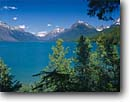 Stock photo. Caption: Lake McDonald   and the Lewis Range Glacier National Park Rocky Mountains, Montana -- landscape landscapes scenic scenics scene summer rockies mountain parks vistas vacation destination destinations water lakes landmarks landmark view classic views vista vistas  glacial silt color turquoise snow capped snowcapped world heritage site sites
