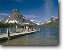 Stock photo. Caption: Two Medicine Lake and Mt. Sinopah Two Medicine Glacier National Park Rocky Mountains, Montana -- landscape landscapes west scenics scenic spring parks destination destinations attraction attractions country world heritage sites boat boats tour tourist sunny clear blue virga person woman people women