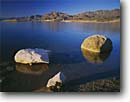 Stock photo. Caption: Boulders at sunrise on Lake Mead   near Devil