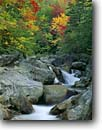 Stock photo. Caption: Ellis River White Mountains White Mountain National Forest New Hampshire,  New England -- waterfall waterfalls creek creeks stream streams parks fall autumn color colors cloudy united states america northeast northeastern parks cascade cascades water flowing foliage landscape landscapes cascading over boulders rocky soft time eternal power