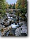 Stock photo. Caption: Ammonoosuc River Bretton Woods White Mountains Coos County, New Hampshire -- parks forests path paths trail trails hike hiking cloudy fall autumn rivers waterfall waterfalls tree trees forest pacific northeast wooden bridge bridges footbridge footbridges england granite bedrock color foliage landscapes landscape sunny clear blue