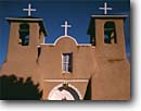Stock photo. Caption: San Francisco de Asis Church Rancho de Taos Sangre de Cristo Mountains New Mexico -- united states america missions historic history americana religion religious cross crosses purity pure spiritual period spanish catholic christian christianity arches archways holy church churches places towers bell tower world heritage site sites pueblo
