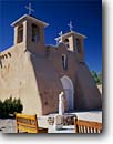 Stock photo. Caption: San Francisco de Asis Mission Church   completed in 1810 Ranch de Taos New Mexico -- churches crosses cross religion united states america worship place places christain christianity cathedrals southwest southwestern catholic historic historical benches adobe sacred statues statue bell bells tower rancho