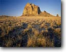 Stock photo. Caption: Ship Rock Navajo Nation San Juan County Colorado Plateau,  New Mexico -- united states landscape landscapes clear scenic scenics scene canyons country distance view views vista vistas plateaus native american land lands sites site indian tribes owned landmarks landmark formation named formations deserts shiprock famous icons
