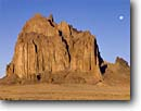 Stock photo. Caption: Ship Rock Navajo Nation San Juan County Colorado Plateau,  New Mexico -- united landscape landscapes clear scenic scenics scene canyons country distance view views vista vistas plateaus native american land lands sites site indian tribes moon landmarks landmark formation named formations deserts shiprock famous icons moons