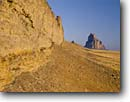 Stock photo. Caption: Ship Rock Navajo Nation San Juan County Colorado Plateau,  New Mexico -- united landscape landscapes clear scenic scenics scene canyons country  view views plateaus native american land lands sites site indian tribes landmarks landmark formation named formations deserts shiprock famous icons grasslands stark blue skies sunny