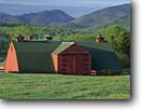 Stock photo. Caption: Barn on dairy farm   and Mount Marcy Adirondack Park Adirondack Mountains, New York -- Heart Lake Road barns farms spring    Adirondacks blue skies clear americana state america rural landscape landscapes northeast northeastern building buildings pastoral heritage solid family ranching ranch livestock sunny clear mountians nestled grassland