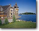 Stock photo. Caption: Boldt Yacht House and Castle Alexandria Bay Wellesley  Island Thousand Islands, New York -- attraction attractions northern  landscape landscapes scenic scenics buildings building summer houses destinations sunny clear blue skies shore shorelines tranquil interlude saint lawrence river opulence luxury wealth historic landmarks landmark islands