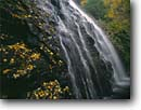 Stock photo. Caption: Crabtree Falls Crabtree Meadows Blue Ridge Parkway Blue Ridge Mountains, North Carolina -- autumn waterfall waterfalls cascade cascades tree trees southern south southeast southeastern tourist travel attraction attractions color colors leaves foliage time exposure appalachia scenics national park parks fall scenic drives drive parkways