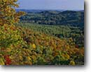 Stock photo. Caption: Blue Valley from Blue Valley Overlook Blue Ridge Mountains Nantahala National Forest Macon County,  North Carolina -- autumn tree trees southern south southeast southeastern america tourist travel attraction attractions color colors landscape landscapes vista vistas distance expanse fall foliage clear sunny blue skies mixed hardwood forests landscape landscapes