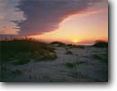 Stock photo. Caption: Sunrise over the Atlantic Ocean Ocracoke Island Cape Hatteras National Seashore North Carolina -- united states seascape seascapes southeast southeastern sunrises beach coast coasts beaches seashores travel tourist destination destinations sand dune dunes sandy windswept ocean transitory shifting parks park oceans morning coast coastline coastlines