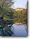 Stock photo. Caption: Biltmore Estate Asheville North Carolina -- attraction attractions northern landscape landscapes buildings building summer houses destinations sunny clear blue opulence luxury wealth historic landmarks landmark historical estates famous east mansion mansions tourist opulent lakes lake  reflections
