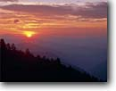 Stock photo. Caption: Sunrise from Newfound Gap Great Smoky Mountains National Park Appalachian Mountains North Carolina -- appalachia united america clouds southern appalachian states parks world heritage site sites sunrises trees mountain landscapes landscape travel tourist destination destinations tranquil ridges fading away elegance emotion time solitude wild scenics
