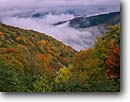 Stock photo. Caption: Breaking storm   from Balsam Mountain Road Great Smoky Mountains National Park North Carolina -- deep creek valley maples maple forest forests hardwood fall autumn foliage parks appalachian appalachia south southern southeast southeastern united states america world heritage site sites pristine landscape landscapes hollows scenics scenic vista view