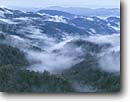 Stock photo. Caption: Lifting fog   from Newfound Gap Great Smoky Mountains National Park North Carolina -- united states america smokies  southeast world heritage site sites spring artistic nature trees tree landscape landscapes forest forests foggy vista vistas view views distance parks smokies