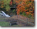 Stock photo. Caption: Red maple and Brandywine Falls Brandywine Creek Cuyahoga Valley National Park Summit County,  Ohio -- maple bench benches fence fences waterfall waterfalls fall autumn color colors resting overlook overlook restful contemplating nature path pathway leisure attractions family emotion pristine picturesque foliage  quiet places sweet solitude interlude calm