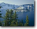 Stock photo. Caption: Mountain hemlocks Wizard Island and Crater Lake Crater Lake National Park Cascade Range, Oregon -- united states america landscape landscapes west areas parks scenic scenics scene overlook overlooks view views cascades western landmark landmarks attraction attractions destinations winter islands snow fresh snow capped peaks peak clear sunny blue lakes