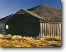Stock photo. Caption: French Round Barn Harney County High Desert Oregon -- united states america  landscape landscapes scenic scenics covered clear moon barns ranches ranch wooden unusual summer moons sunny skies blue dwserts nostalgia wood yesteryear