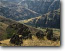 Stock photo. Caption: Lava outcrops Grande Ronde River Wallowa County Oregon -- united states america rural landscape landscapes ranch ranching ranchland agriculture farming pacific northwest northwestern country living high desert volcanic origin building buildings geology geologic volcanic rocks