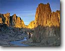 Stock photo. Caption: The Crooked River and Smith Rocks   at sunrise Smith Rocks State Park High Desert,  Oregon -- united states america sagebrush country deserts clear blue skies sky open solitude freedom climbing destination destinations climber rivers spire spires cliff cliffs face faces geology geologic formation formations tourist rock