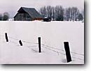 Stock photo. Caption: Ranch near Fort Klamath Klamath County Oregon -- barns barn winter rural snow fence snowy roof white ranches ranching country countryside quaint fences cold tree trees americana west barb wire fences snowfall isolated isolation solitude freedom quiet solid heritage landscape landscapes scenics stark