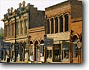 Stock photo. Caption: Historic buildings California Street Jacksonville Oregon -- building shop shops historical district districts mainstreet nostalgia nostalgic united states america business businesses commercial commerce painted signs brick historic vintage heritage facades facade towns town cities city small southern street main