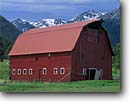 Stock photo. Caption: Barn near Joseph and the Wallowa Mountains  in the Eagle Cap Wilderness Oregon -- areas area wildernesses barns crimsom roof mountain blue fence large northwest green grass ranch ranches ranching country rural countryside quaint clear sunny sunshine summer agriculture americana snow capped building buildings door landscape landscapes