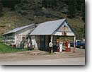 Stock photo. Caption: Gas station, Rochford Black Hills, South Dakota -- tourist attraction historic historical americana old west gas stations pump gas pumps united states america small town america nostalgia rustic memories oldtime quaint nostalgic pumping spring building buildings truck parked