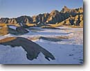 Stock photo. Caption: The Castle Badlands National Park South Dakota -- great plains short grass prairie  prairies united states america landscape landscapes badland parks  erosion eroded snow winter covered fresh