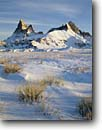 Stock photo. Caption: Winter sunrise Badlands National Park South Dakota -- parks united states america tourist travel destination destinations attraction attractions landscape landscapes scenic scenics snowfall snow cold sunrises peaks peak badland freezing