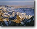 Stock photo. Caption: Badlands at the head of Rake Creek from near Big Badlands Overlook Badlands National Park South Dakota -- parks united states america tourist travel destination destinations attraction attractions landscape landscapes scenic scenics snowfall snow cold sunrises peaks peak badland freezing erosion eroded offseason