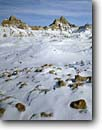 Stock photo. Caption: Winter afternoon Badlands National Park South Dakota -- parks united states america tourist travel destination destinations attraction attractions landscape landscapes scenic scenics snowfall snow cold sunrises peaks peak badland freezing