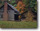 Stock photo. Caption: Henry Whitehead Cabin Cades Cove Great Smoky Mountains National Park Tennessee -- world heritage site sites parks appalachian fall autumn hardwood forest forests south southern rural homestead homesteads cabins historic historical americana chimney chimneys stone brick foliage building buildings heritage attraction attractions