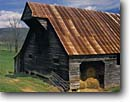 Stock photo. Caption: Hay barn Cades Cove Great Smoky Mountains National Park Appalachian Mountains,  Tennessee -- world heritage site sites parks coves appalachian spring south southern rural homestead homesteads historic historical americana barns agriculture building buildings working landscape landscapes scenic scenics weathered determination sunny blue clear