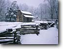 Stock photo. Caption: John Oliver Place Cades Cove Great Smoky Mountains National Park Tennessee -- snow snowfall snowstorm storm stormy fence split rail fences homestead homesteads winter wintery cold cabin cabins appalachia appalachian southern southeastern southeast parks world heritage site sites building buildings heritage house houses