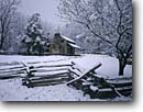 Stock photo. Caption: John Oliver Place Cades Cove Great Smoky Mountains National Park Tennessee -- snow snowfall snowstorm stormy fence split rail fences homestead homesteads winter cold cabin cabins appalachia appalachian southern southeastern southeast heritage building buildings parks world heritage site historic historical restored house houses